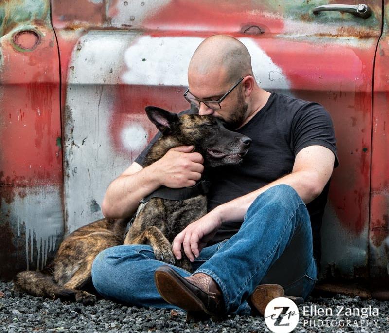 Photo of man hugging his dog by Ellen Zangla Photography in Loudoun County VA