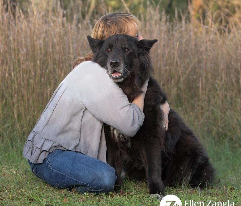 Photo of woman hugging her dog in Loudoun County VA by Ellen Zangla Photography