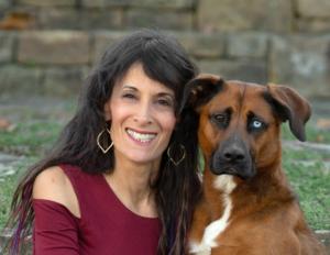 Photographer Ellen Zangla, owner of Ellen Zangla Photography, with her dog Lola