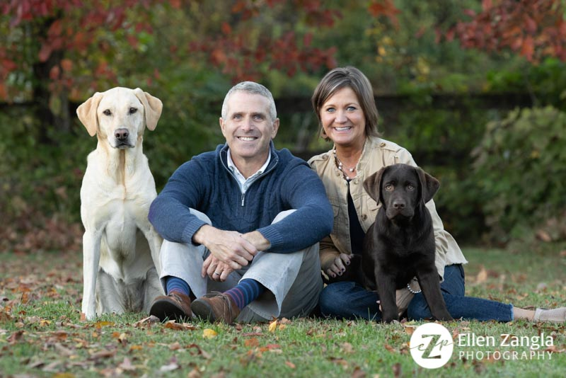 Photo of couple and their two dogs taken in the fall in Loudoun County VA by Ellen Zangla Photography