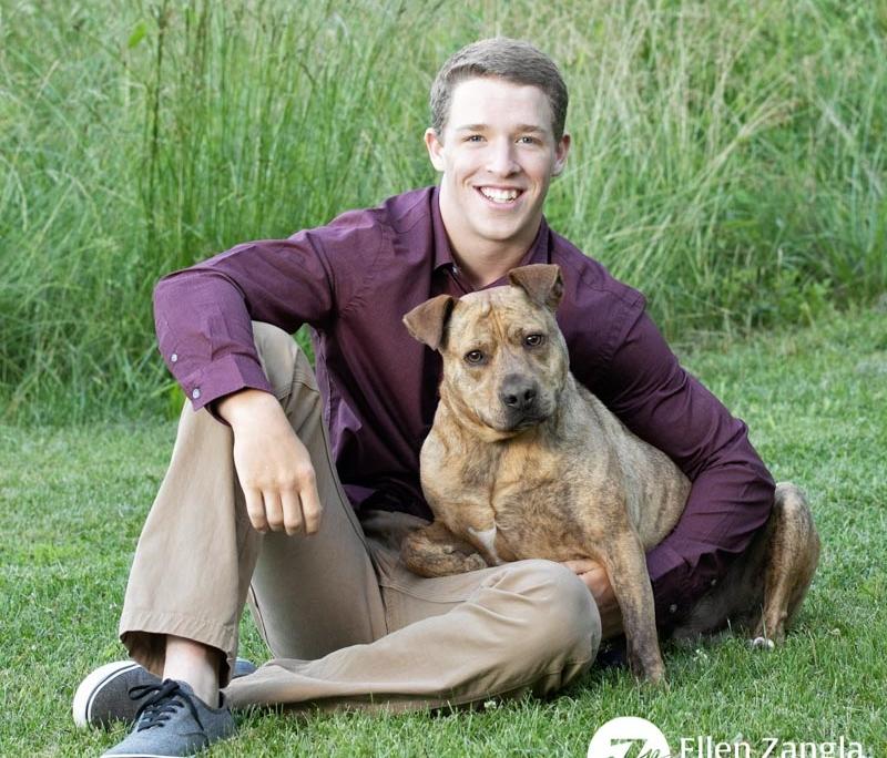 Photo of high school senior and his dog by Ellen Zangla Photography in Loudoun County VA